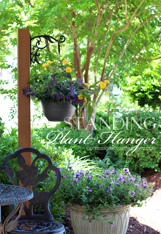 DIY Standing Outdoor Plant Hanger from Confessions of a Serial Do-it-Yourselfer. Adding another hanger to the other side would make it great for pool towels as well!