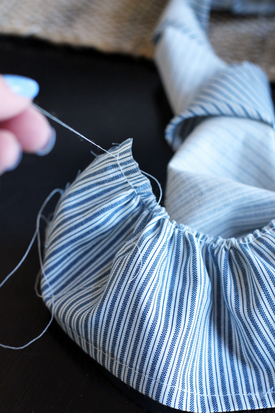 To ruffle fabric, baste along one edge. Then take one of the threads at the start and gently pull as you push the fabric along, causing the fabric to ruffle.