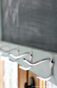 Add hooks to a chalkboard to add even more function!