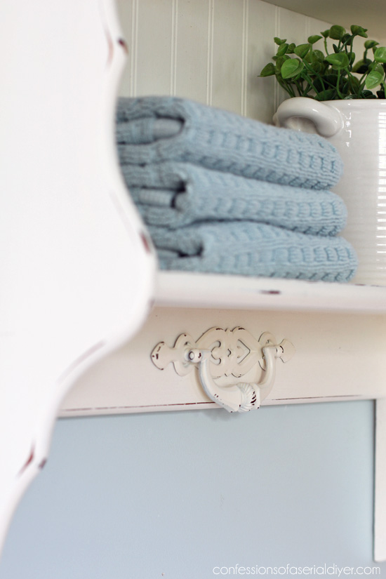 Add an old drawer handle to embellish a boring piece!