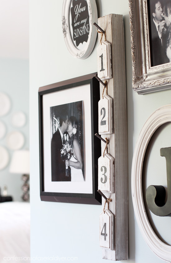 Epic Take a Number fun wall decor created from old picket fence parts from