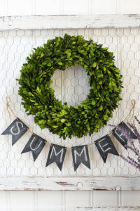 A frame of chicken wire makes a perfect backdrop for a wreath! This one was a dated Fall print to start.