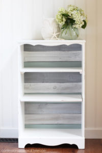 Bookcase makeover using old fence pickets for the backing. Now it's a coastal cutie! Confessions of a Serial Do-it-Yourselfer