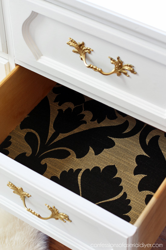 Line the drawers of your dresser with fabric using Mod Podge.