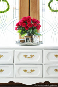 White Painted Vintage Dresser Makeover from confessionsofaserialdiyer.com