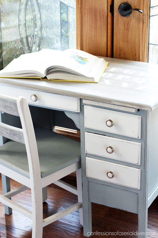 Child's antique desk with a weathered wood top and chalk painted bottom from confessionsofaserialdiyer.com