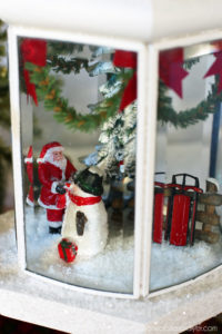 Holiday Globe made from an old light fixure from confessionsofaserialdiyer.com