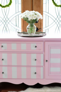 Pink and white striped dresser from confessionsofaserialdiyer.com