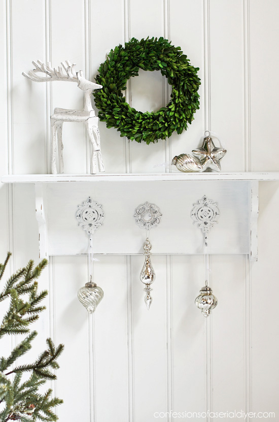 Thrift store shelf gets a simple white makeover from confessionsofaserialdiyer.com