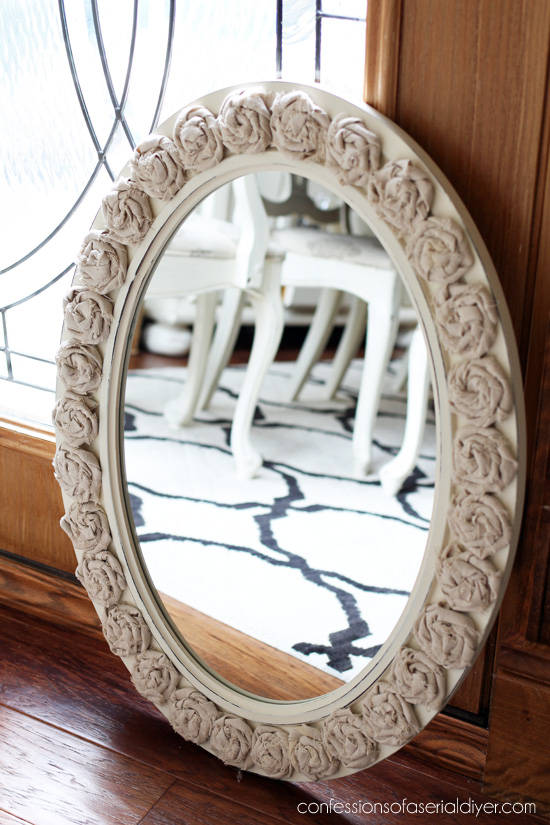 Oval mirror made with rag rosettes from confessionsofaserialdiyer.com