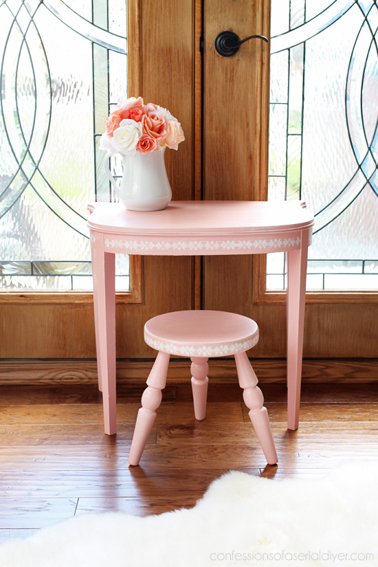 Little girl's vanity set from an antique side table and stool. confessionsofaserialdiyer.com