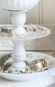 Jewelry organizer made from repurposing pretty dishes from confessionsofaserialdiyer.com
