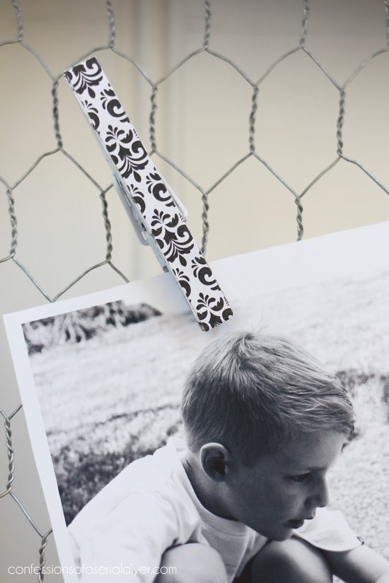 Make matching photo holders using clothespins and scrapbook paper.