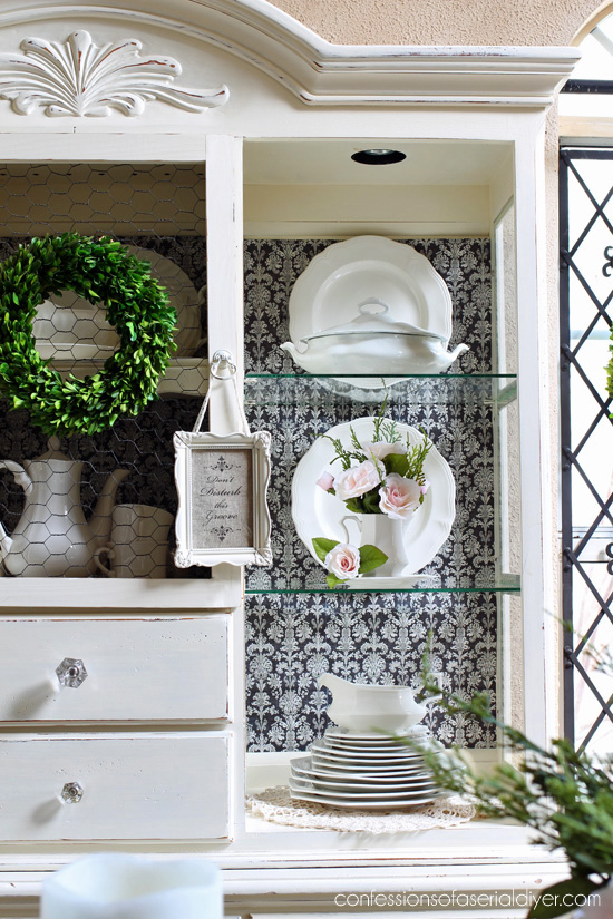 Miniature blush roses added a pretty touch of Spring to this hutch whn added to a few ironstone pieces.