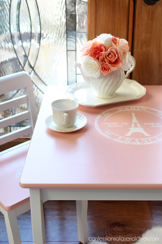 Girl's Table and chair set painted and stenciled with a french-inspired theme from Confessions fo a Serial DIYer