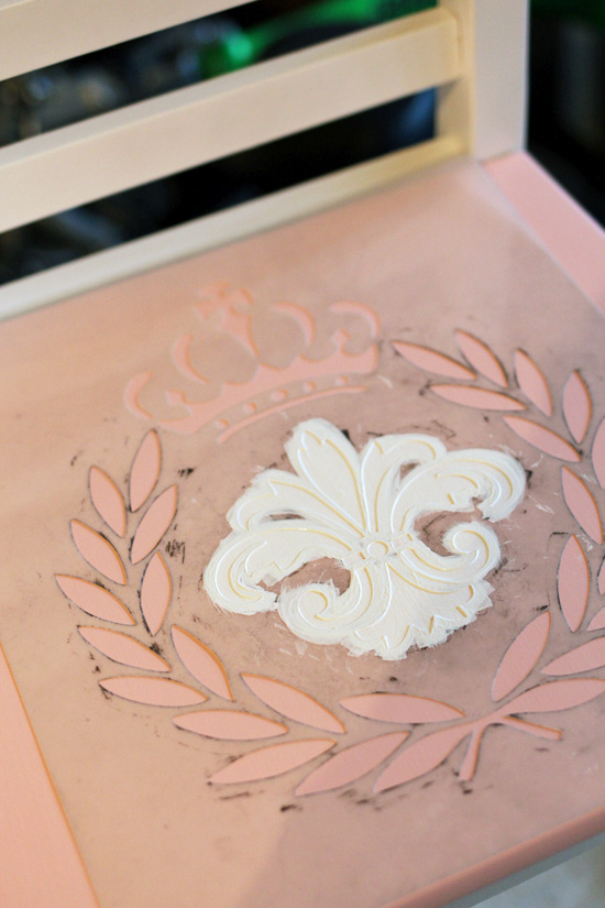 Add a sweet stencil to add personality to a painted piece.