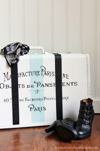 Vintage suitcase updated with paint and a french graphic. confessionsofaserialdiyer.com