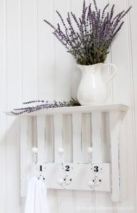 Chair repurposed into a shelf from confessionsofaserialdiyer.com