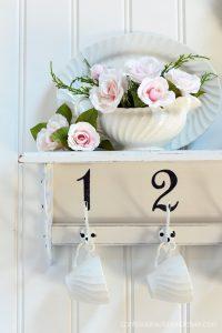 Turn a thrift store shelf into a pretty new mug rack!