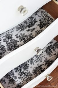 Love black toile to line the drawers of white-painted pieces.
