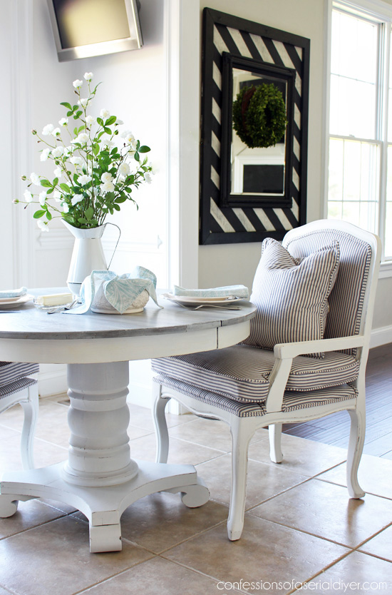 Whitewashed pedestal kitchen table from confessionsofaserialdiyer.com