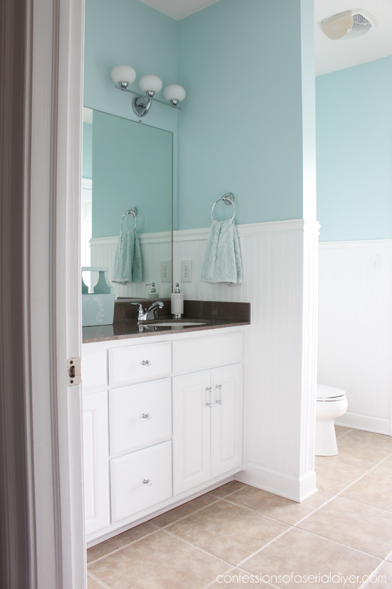 Cute Guest bath makeover with wainscoting from confessionsofaserialdiyer