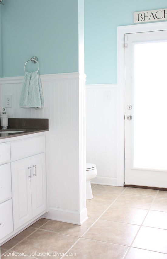 Beautiful Guest bath makeover with wainscoting from confessionsofaserialdiyer