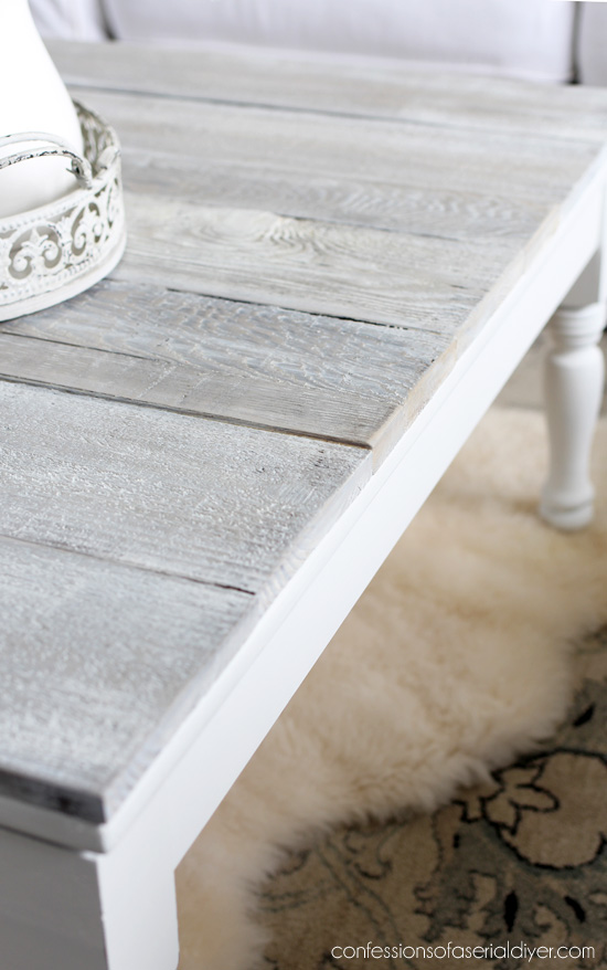 White washed wood plank coffee table from confessionsofaserialdiyer.com