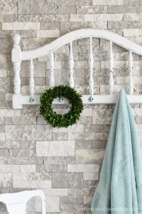 Turn a headboard into a coat rack or towel holder!