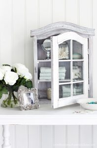 Rustic thrift store cabinet gone coastal from confessionsofaserialdiyer.com