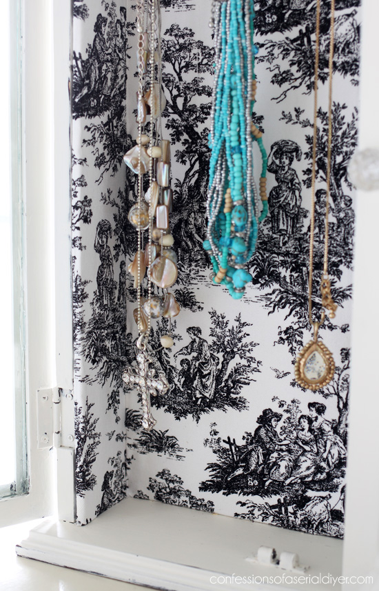 Necklace Organizer from a thrift store wall cabinet.