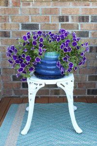 Reuse old bistro chairs as plant stands by removing the backs!