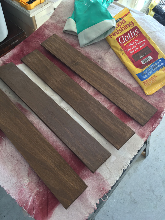 Minwax staining cloths in walnut are great for staining bare wood before painting to give you that rich wood color underneath when sanding.