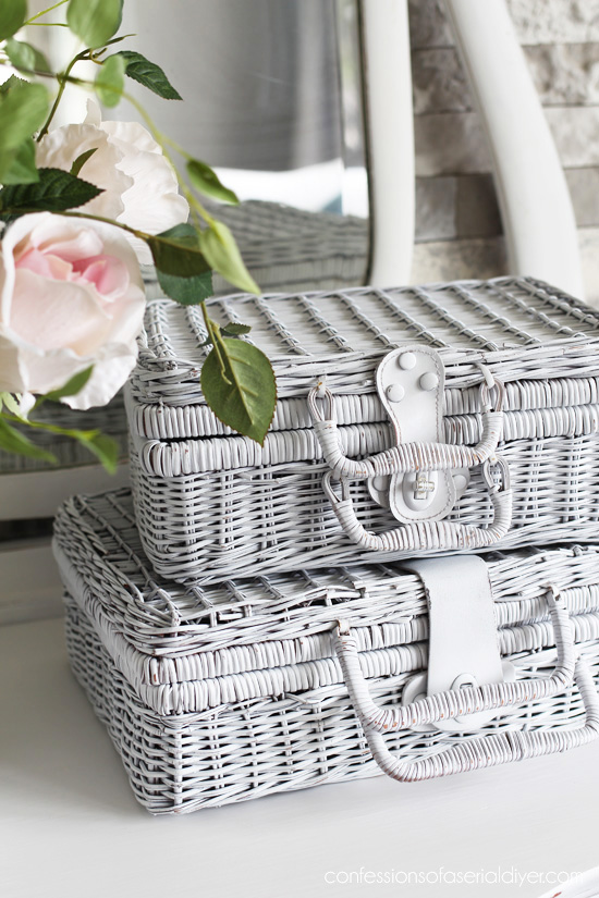 Picnic baskets spray painted and stacked make great decor!