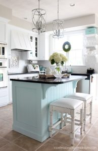 Updated kitchen island with 1X4s and beadboard from confessionsofaserialdiyer.comn
