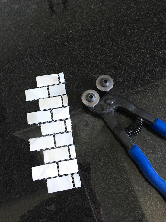 Glass tile nippers worked great for cutting these small tiles.