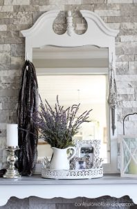 Adding hooks to the frame of a mirror like this gives it another purpose!