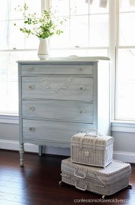 Blue dresser with whitewash finish from confessionsofaserialdiyer.com