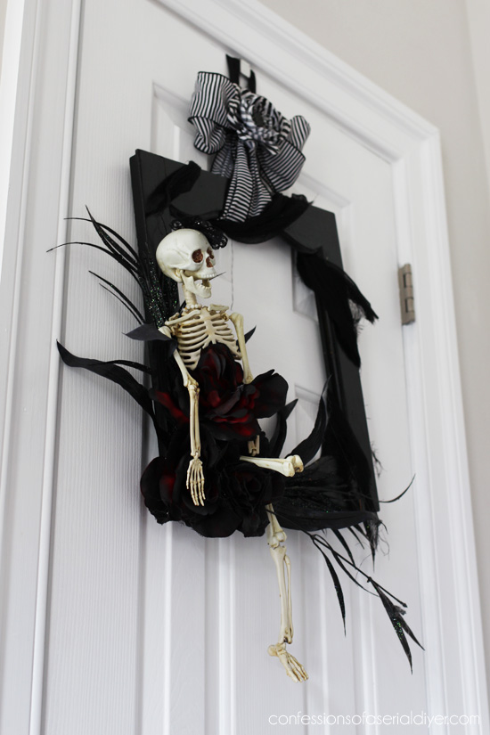 Halloween wreath made from a cabinet door from confessionsofaserialdiyer.com