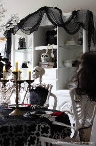 Halloween dining room skeleton party from confessionsofaserialdiyer.com