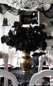 Spray paint old florals black for an easy Halloween centerpiece!