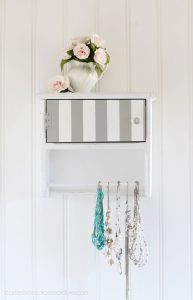 80's Towel Bar shelf repurposed into necklace storage from confessionsofaserialdiyer.com