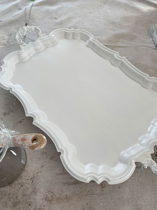 Silver tray painted with DIY chalk paint.