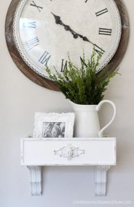 Turn and old drawer and a pair of brackets into a cute wall shelf.