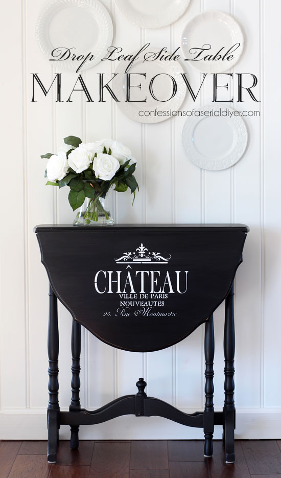 Drop leaf side table painted black with the addition of graphics.