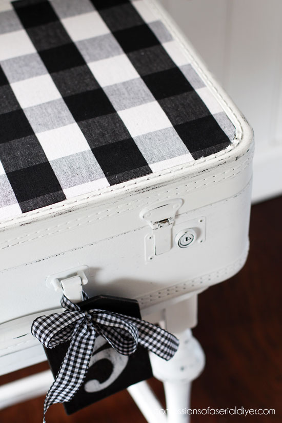 Vintage suitcase made over with buffalo check charm from confessionsofaserialdiyer.com