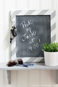Add a chalkboard to a small shelf as a great catch-all by the front door.
