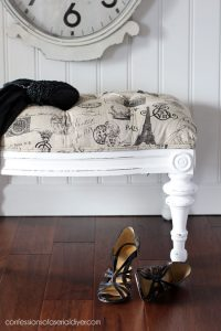 Recovering a tufted footstool.