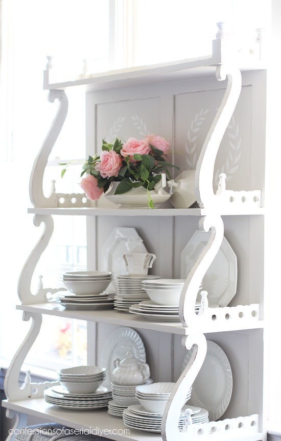 Painted shelving unit from convessionsofaserialdiyer.com