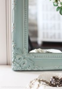 Gold thrift store mirror painted in a coastal hue.